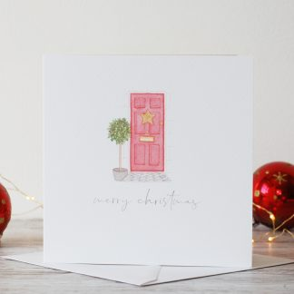 Watercolour festive red front door christmas card by Kerri Awosile with red baubles