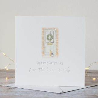 Watercolour festive front door personalised Christmas card with family name by Kerri Awosile with lights