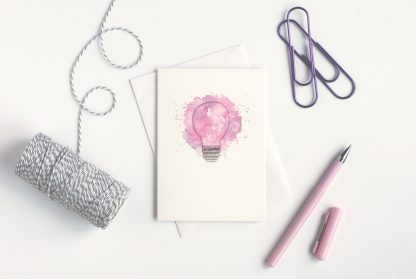 light bulb card with pen, paper clip, and string