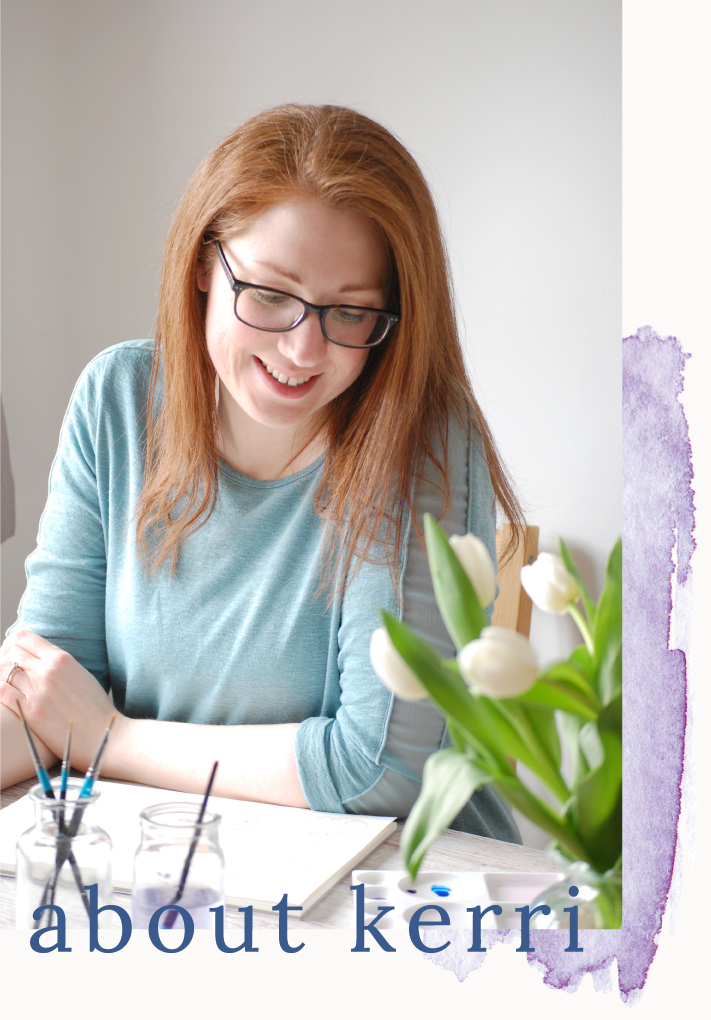 Kerri Awosile artist, writer, and designer doing watercolour painting at desk with white tulips