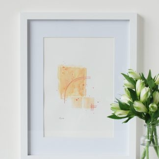 sunrise original watercolour artwork by Kerri Awosile, framed on table with white flowers