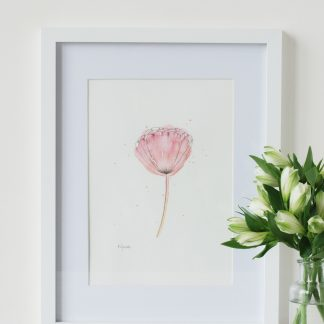 Floral Sunrise Watercolour original painting by Kerri Awosile, framed and on table with white flowers