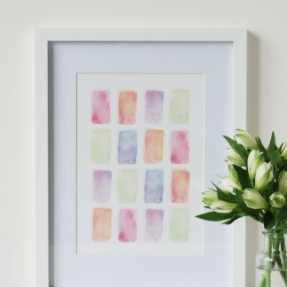 Colourful Life watercolour art print by Kerri Awosile, framed and with white flowers on table