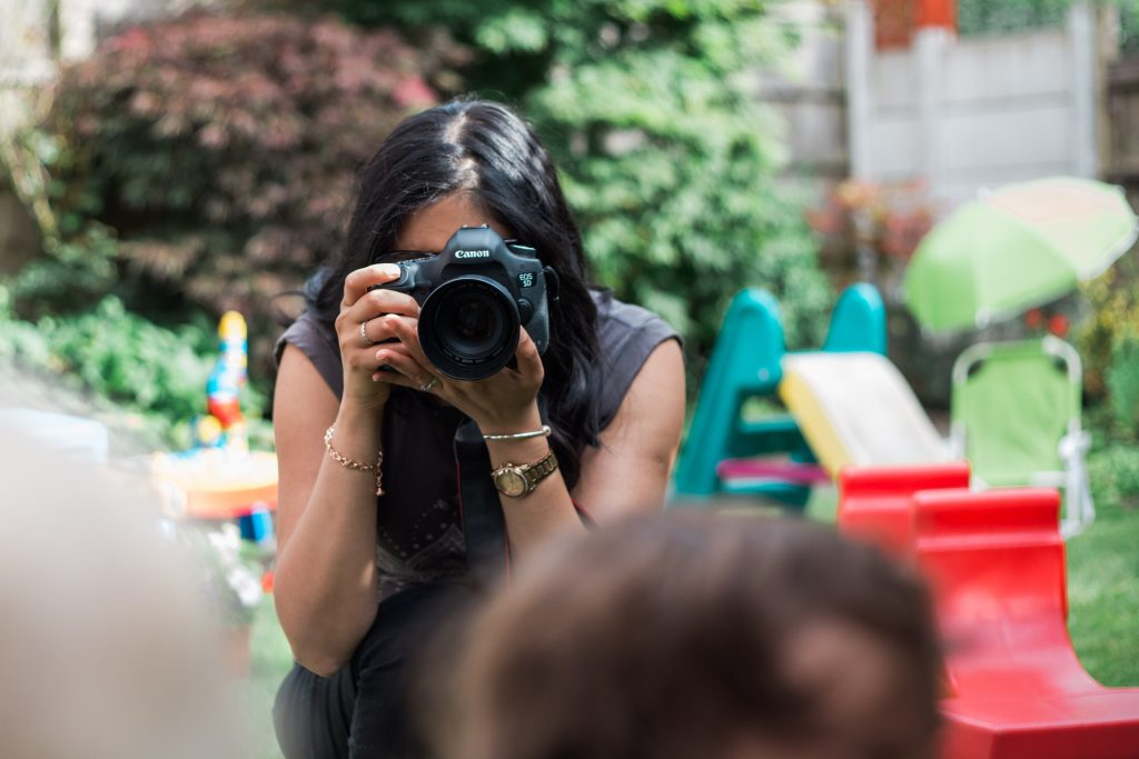 Deepa Rodrigues taking photographs of family