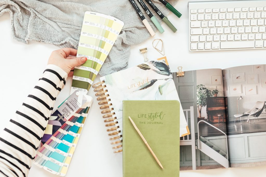 Flatlay of LIFEstyled planner with Lou Rodrigues