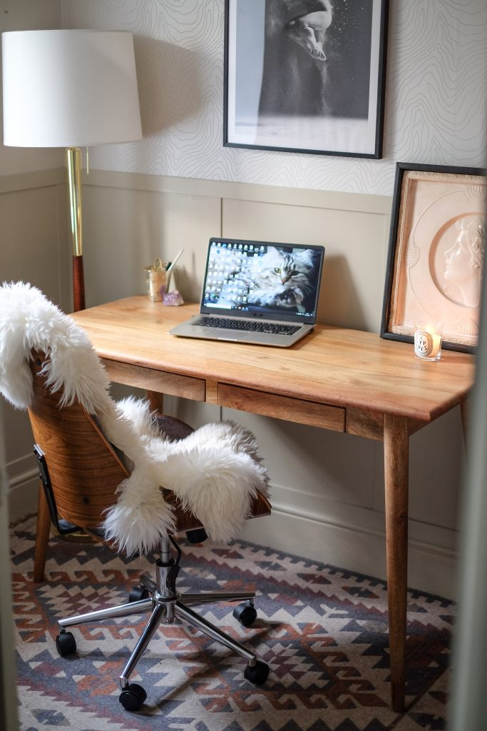 desk, chair, lamp, lamptop, and artwork in Ceri Olofson's stylish office