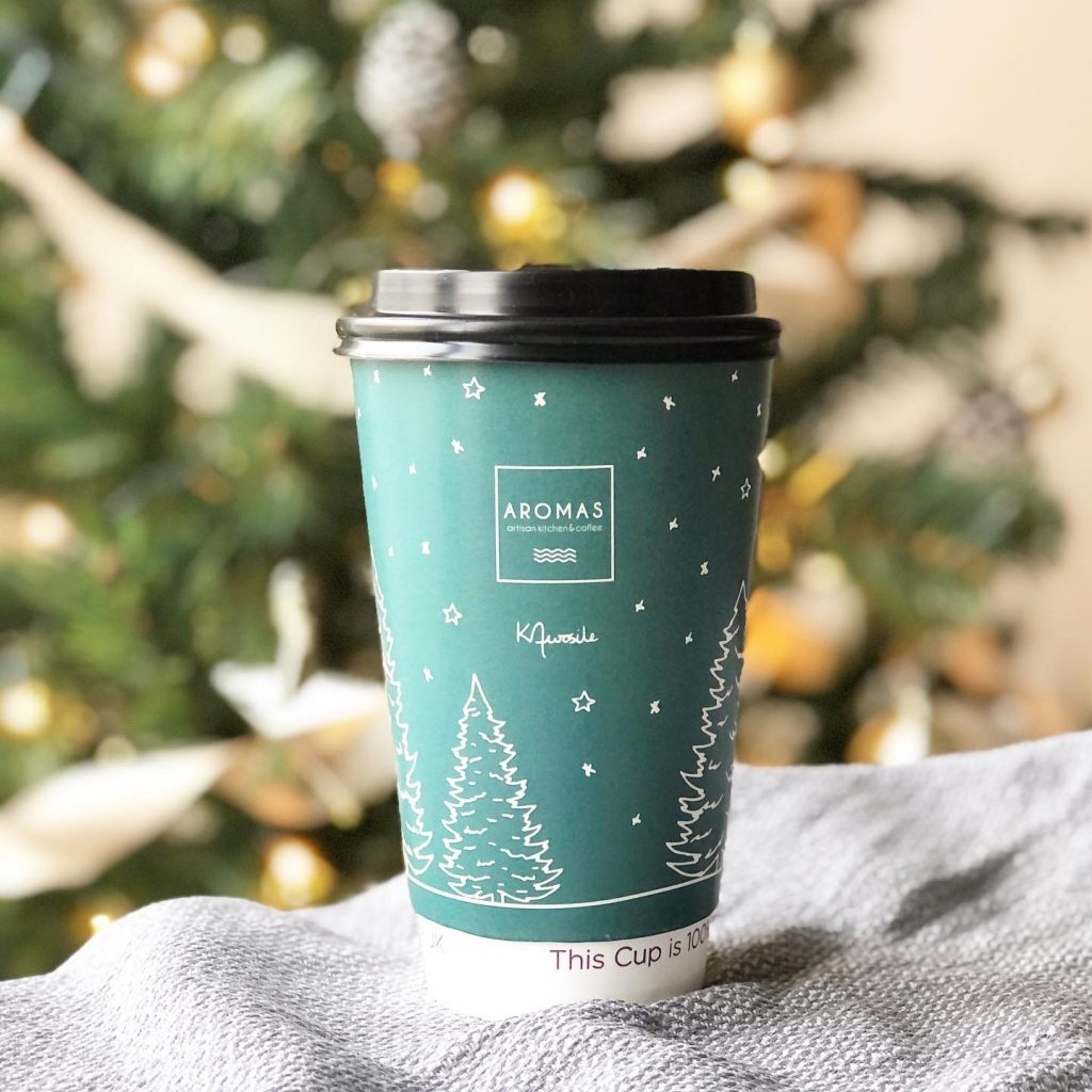 Aromas cafe coffee cup design with winter trees illustration by Kerri Awosile