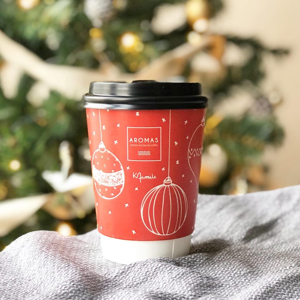 Christmas coffee cup design for Aromas cafe in Weybridge by local artist and designer Kerri Awosile