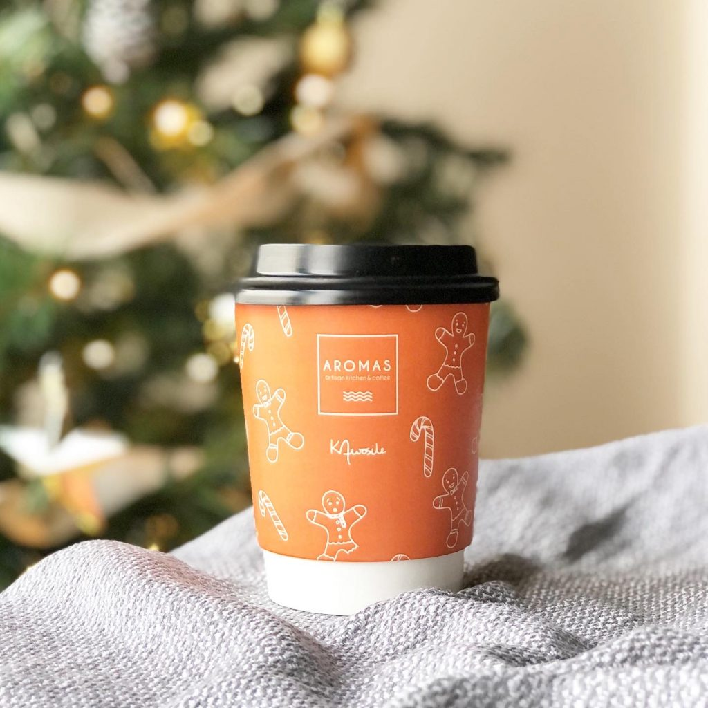 Aromas coffee take-away cup with gingerbread men and candy canes by UK artist Kerri Awosile