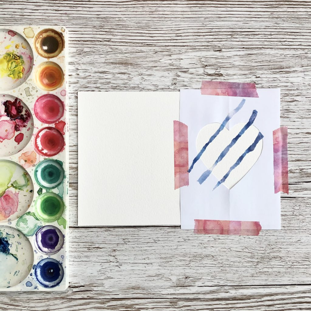DIY watercolour rainbow heart card prep with diagonal washi tape