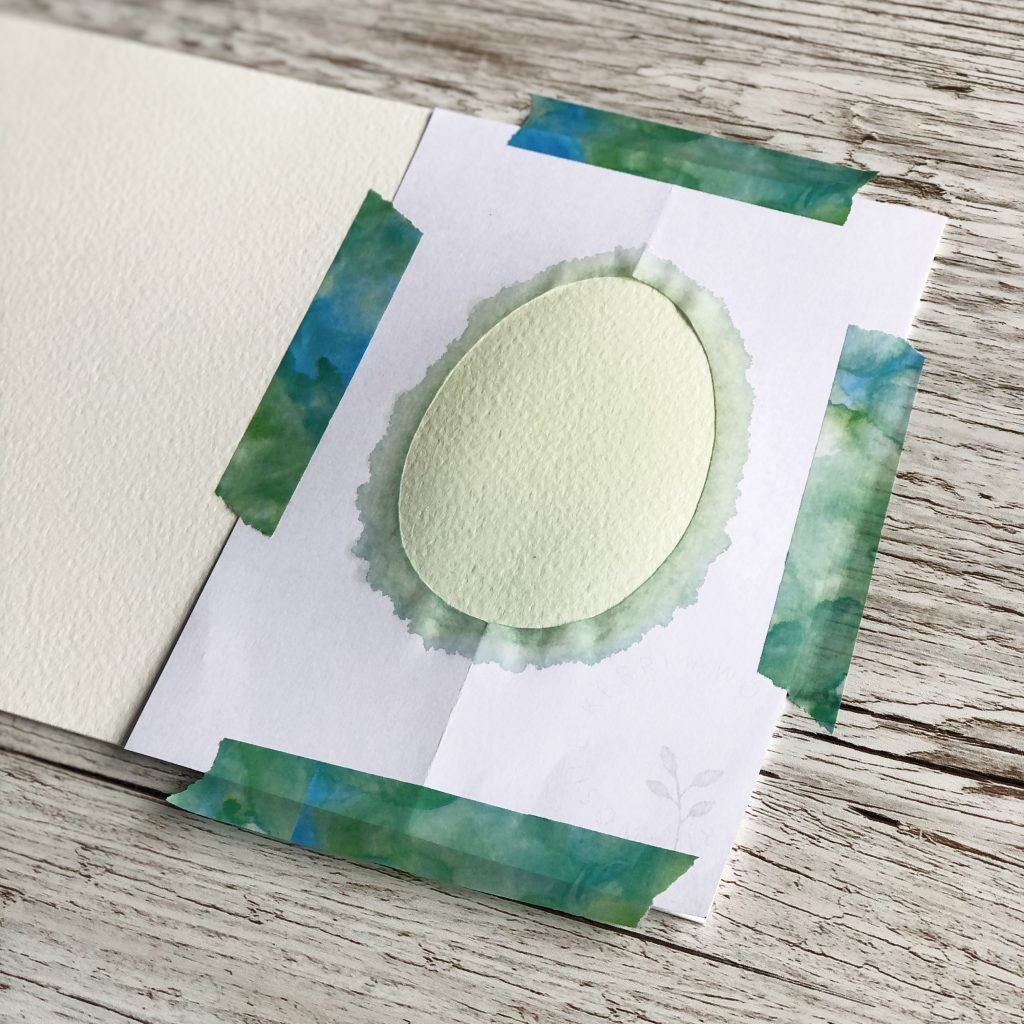 First layer of paint for DIY watercolour Easter egg card tutorial project by UK artist Kerri Awosile